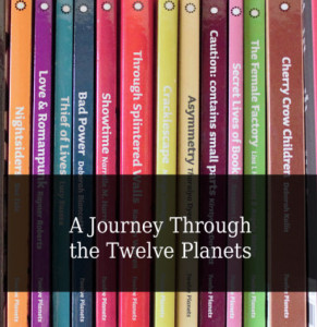 Image of a series of vertical book spines showing the twelve planet books in various colours. Header text white on transparent black overlies the image with the title 'A Journey Through the Twelve Planets'.