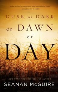 Cover image with large text with the author and book title, the background is a golden soft glow horizon behind a field of golden corn.